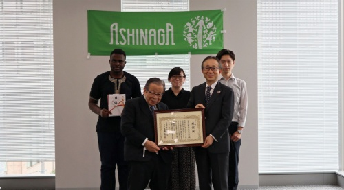 Presenting a donation to support students  at the Ashinaga Foundation