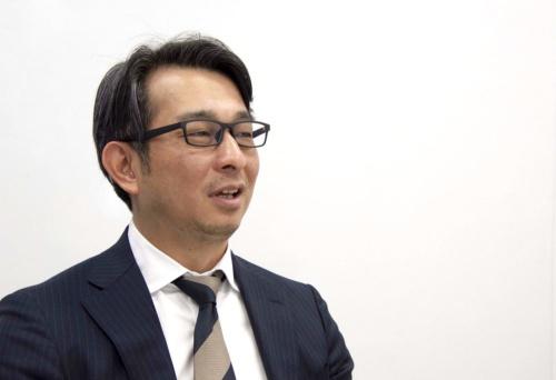 北海道日本ハムファイターズの前沢賢・取締役事業統轄本部長(写真:日経BP 総合研究所)