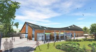 建物側面のイメージ。大屋根がゆるやかな曲線を描く(画像:キユーピー)