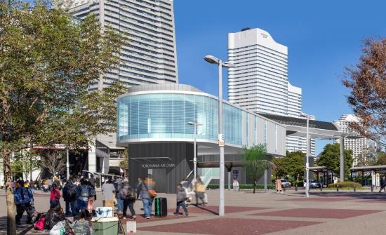 (図4)JR桜木町駅前の停留所イメージ。ここから右手方面に向けて、ゴンドラは出発することになる。停留所の背景、左手に見えるのは、横浜ランドマークタワー(資料提供:泉陽興業)