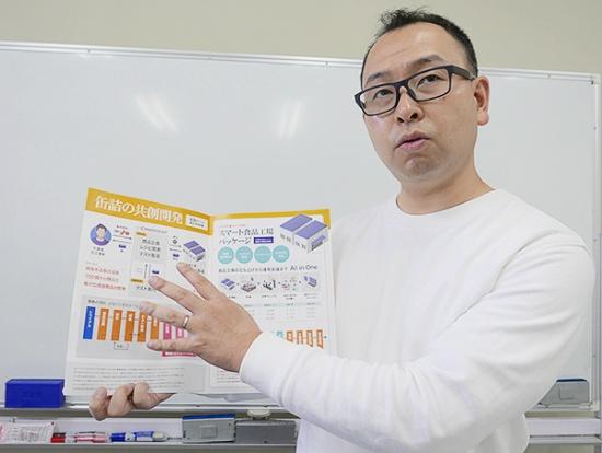 自社のビジネスモデルを語るカンブライト代表取締役社長の井上和馬氏(写真:高山 和良)