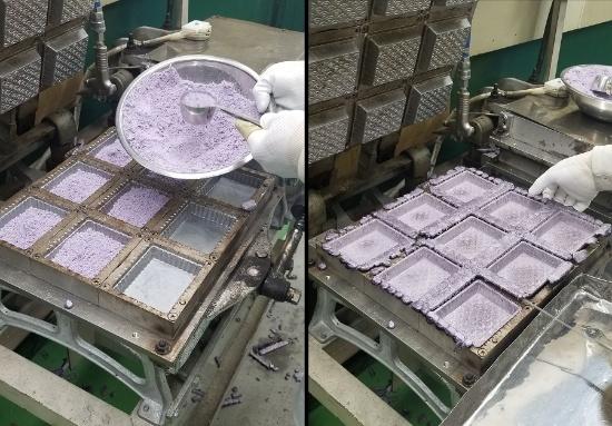 紫いも味のトレイの焼成作業(写真提供:丸繁製菓)
