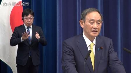 記者会見中の菅総理大臣